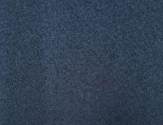Dark blue tweed. 100% Polyester. Great multipurpose fabric!