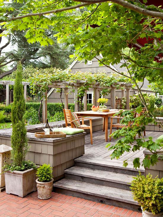 A overhead pergola adds extra greenery to this simple patio. See more inspiring outdoor spaces: http://www.bhg.com/home-improvement/porch/outdoor-rooms/small-outdoor-living-spaces/?socsrc=bhgpin050913pergolapatio=15: