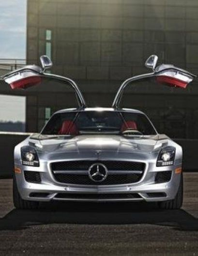 The mercedes benz sls amg takes cool to a whole new level for Mercedes benz with wing doors