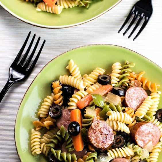Smoked Sausage Pasta Salad Recipe Salads with rotini, canola oil, smoked sausage, carrots, green pepper, small yellow onion, black olives, italian salad dressing