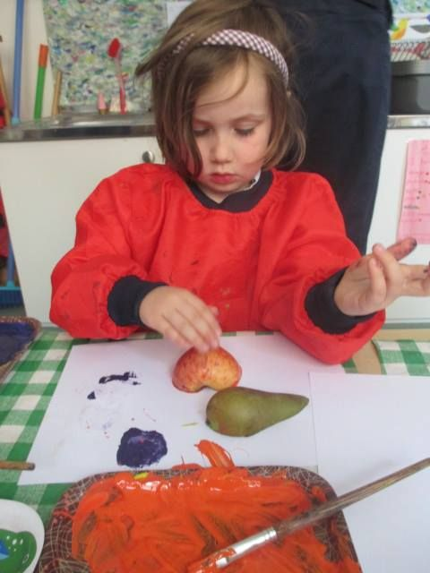 Printing with fruit and paint.