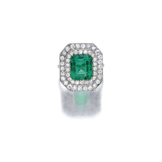 Emerald and Diamond Ring, Spaulding & Co. Set with a step-cut emerald…