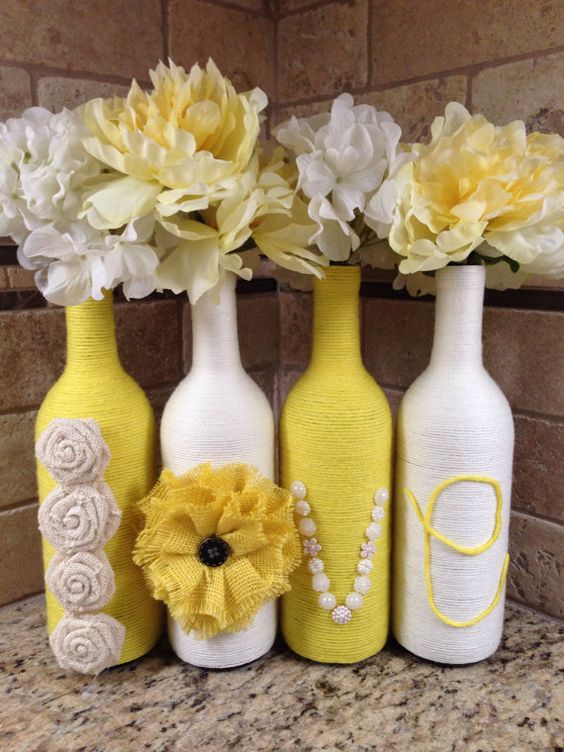 This listing is for four hand wrapped wine bottles featuring the word Love. All four bottles are wrapped in yarn and are embellished in: