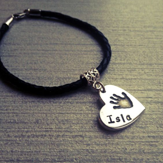 Braided leather bracelet with handprint heart charm