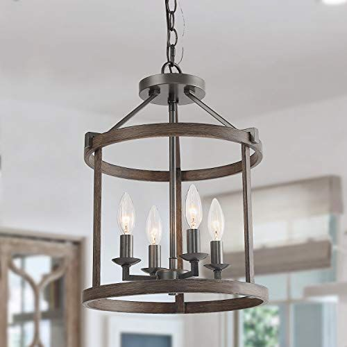 Farmhouse Style Clean Modern Lines In This Wrought Iron Chandelier Give A Strong Start To A N Rustic Chandelier Farmhouse Chandeliers Farmhouse Style Lighting Iron and wood chandelier