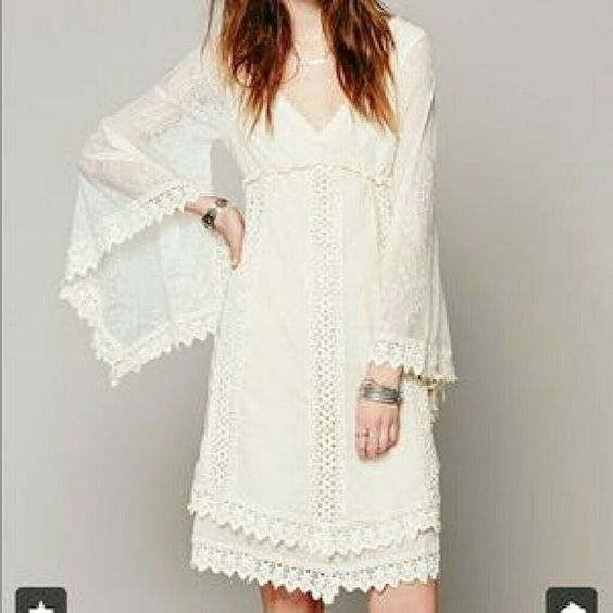 Free people nightingale ivory dress This dress is gorgeous! The lace sleeves are very wide and flowy. I never wore this. It still has the tag attached. Size xs Free People Dresses
