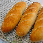 French Baguette - an authentic recipe with only 4 ingredients; water, sea salt, yeast & flour. Learn how to make perfect crusty baguette & mini baguettes.
