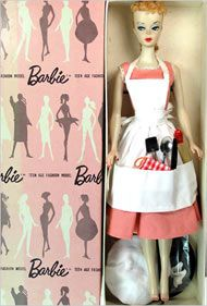 A 1959 blond Barbie in its original packaging. Those 59 dolls were not very pretty! But I loved this outfit when I got it.