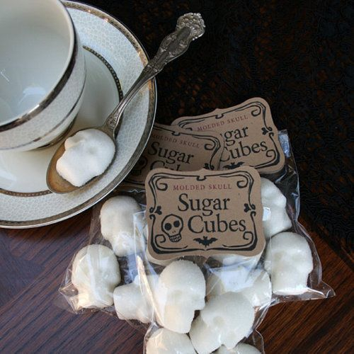 Skull Sugar Cubes- Would be easy to make with some molds from the Dia de los Muertos shops. Or these as favors!!!