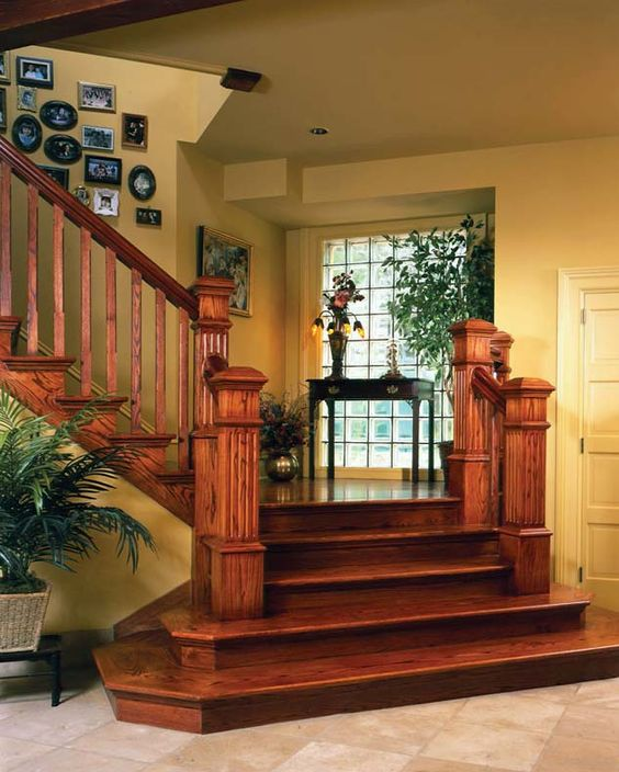 bottom stairs have no railing-- keeps entryway more open (don't like the all stained look, though!)