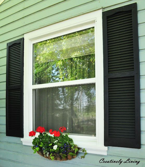 Shutters, window boxes, adding and painting trim. Glad to be done with all of that!