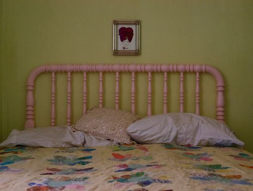 My girl's bedroom. Simple. Pink. Citron green. Vintage quilt made by her great grandma. Some Waldorf dolls and playstands. And not much else.