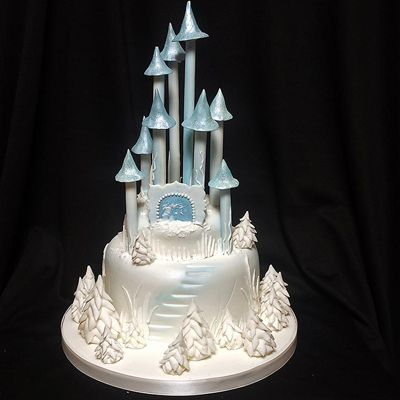 Learn to make this Frozen castle birthday cake at www.quicksugarcraft.com