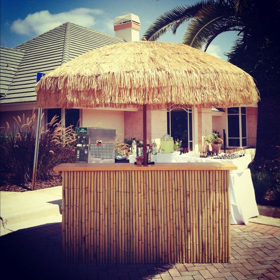 Our custom Bamboo Tiki Bar and Umbrella - perfect for outdoor events and tropical themed parties.