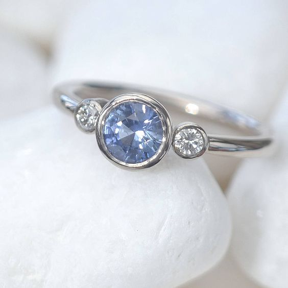 Blue Sapphire Engagement Ring With Diamonds. This style but in silver and different gemstones.