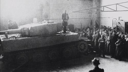 Original photos of Michael Wittmann giving a speech while standing on a Tiger Tank at the Henschel factory where Tiger Tanks were made, 1943