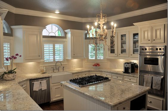The white cabinets with a lighter slab of the Bianco Romano granite definitely give a more calm feel to the room. Just a little gray and other color through the slab highlights the gray in the upper portion of the walls.