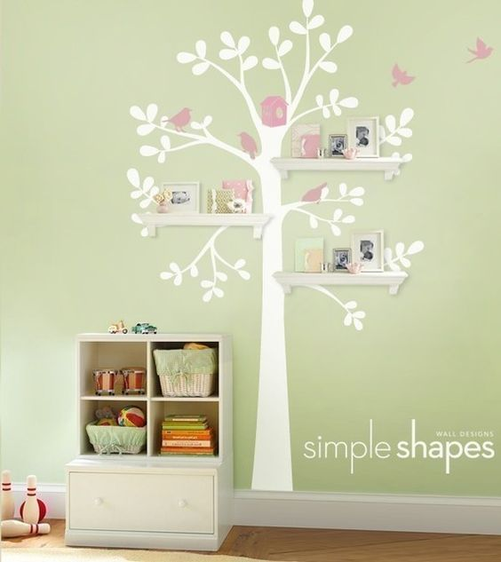 Love the shelves on the painted tree...Great idea.  You could even hang things from the shelves to make them look like they are a part of the tree....  <3 <3 <3