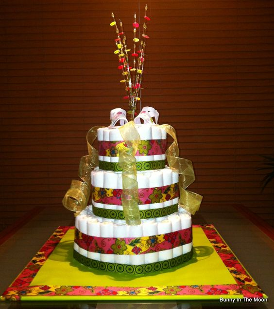 Diaper Cake!  108 individually rolled diapers topped with a pair of shoes.