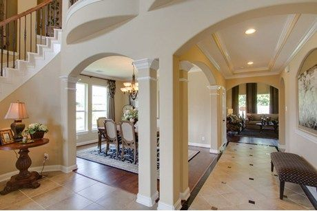 Elegant columns define the dining space of the Laguna II plan. This new home built by CastleRock  Communities at Stone Creek Ranch in Hockley, Texas is featured on NewHomeSource.TV in Houston.