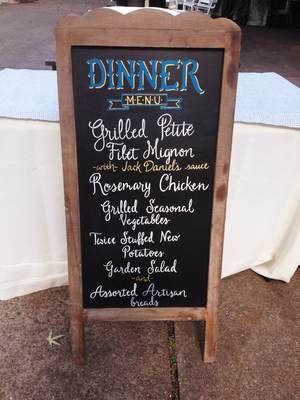 Hand-drawn chalkboard sign for wedding reception dinner menu
