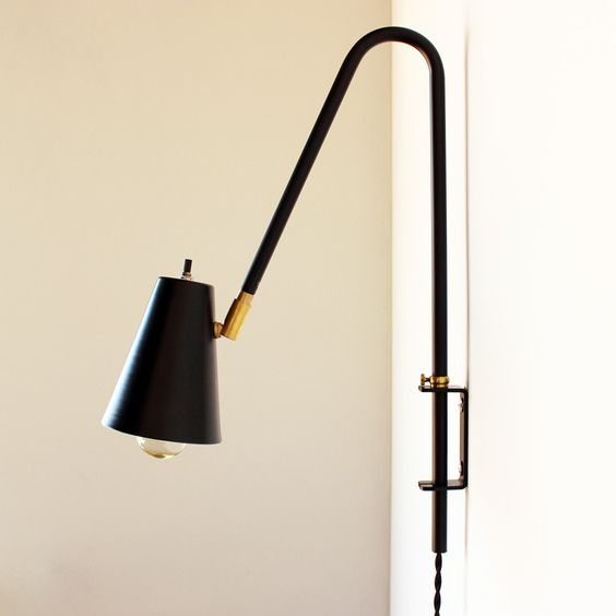 """Wallace lamp, sold out!  This is a wall-mount swing lamp made by me. Durable powder-coated finish in matte black or gloss white. Measures 18"""" from top of arch to bottom of tube. Lamp shade is about 12"""" from wall. Shade is 4"""" diameter by 5-1/4"""" deep and swivels on brass fitting with an on-off switch at back of shade. Wall bracket is powder-coated aluminum. Adjustable height with thumb screw. Cloth twisted cord. Made to order in about 2-4 weeks."""