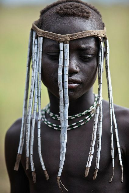 'Young woman from Mursi tribe decorated,' Ethiopia, by Dutch documentary photographer Ingetje Tadros. ty, this beadiful world. via Getty Images