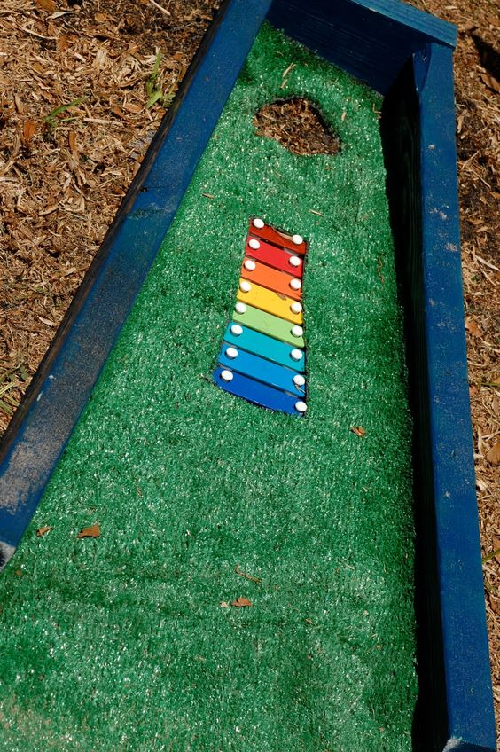 I was wondering about this idea for weeks and there it was on Pinterest today- Erin and Nathan can create this music hole when they visit- I would want lots of Xylephones! Putt Putt Golf