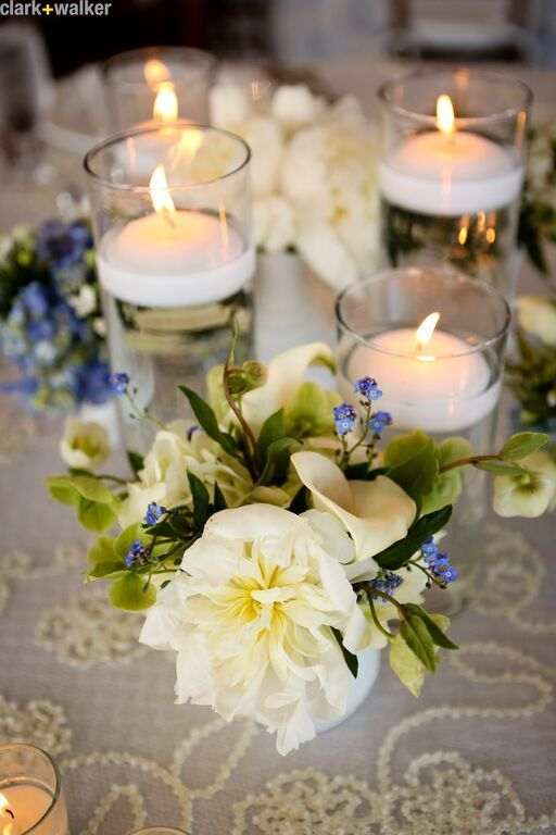 Cute table setting idea flowers white blue candles