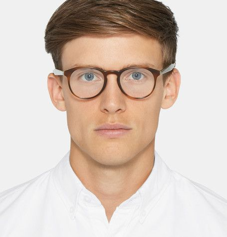 <a href='http://www.mrporter.com/mens/Designers/Prada'>Prada</a>'s optical glasses have been skilfully crafted in Italy from lightweight acetate - the marbled brown palette is softer than black and suits an array of hair colours and skin tones. They're designed in a sophisticated round shape that looks particularly flattering on more angular faces. Add your own choice of prescription or UV-protective lenses.