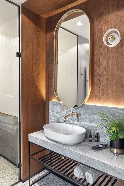 Modern bathroom design with walk-in shower, large oval mirror and vessel sink #bathroom #moderndesign