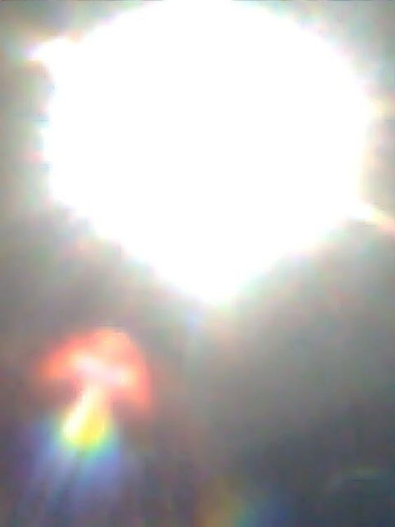 Sun in Medjugorje-30th Anniversary: Photo taken of the dancing sun with a dove like figure during the 30th anniversary celebration of the apparitions at Medjugorje .: