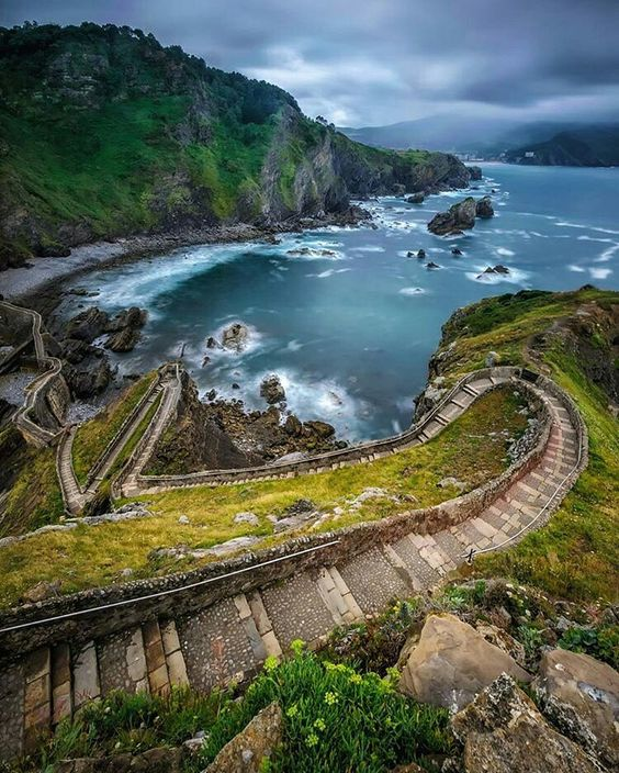 San Juan de Gaztelugatxe, Spain. The climb down the hill, across the bridge and…