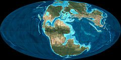Jurassic Period: 201 MYA-145 Mya); end of Triassic to beginning of Cretaceous; middle period of Mesozoic Era; age of reptiles; start of period marked by Triassic-Jurassic extinction event; supercontinent Pangaea beginning to rift into 2 landmasses, Laurasia and Gondwana; created more coastlines and shifted continental climate from dry to humid; many arid deserts replaced by lush rain forests