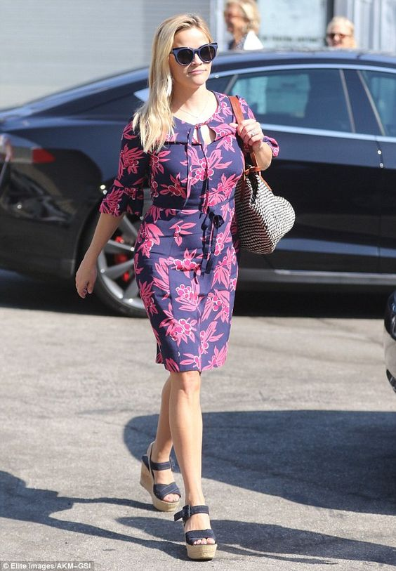 Pretty in pink! Reese Witherspoon showed off her trim figure in a stylish, fitted dress for Sunday services in Santa Monica