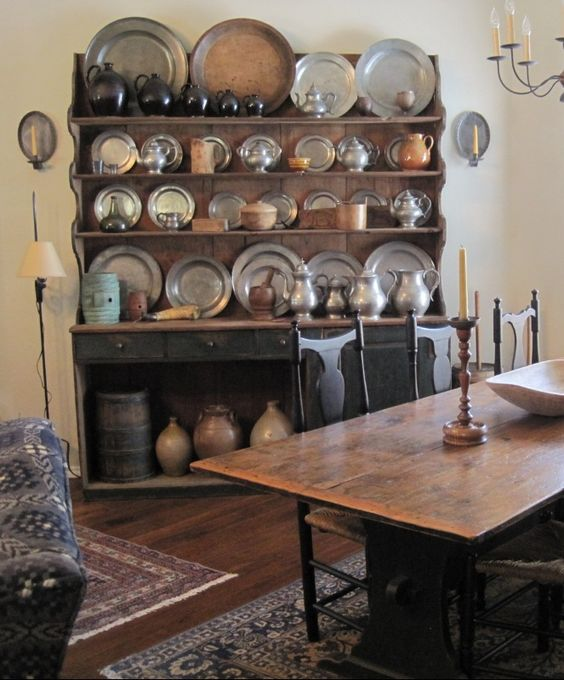 Primitive cupboards with bright shiney pewter, Pottery mixed in, my heart is a flutter.  Treenware and Firkins and Crocks make me sing,  These are a few of my favorite things....    love this mix folks, can't help but sing about it! ;-)