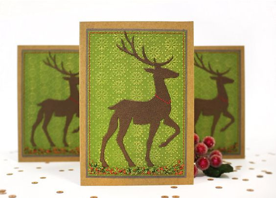 Handmade Paper Reindeer A6 Gift Cards made of craft paper, embossed green cardstock with light gold touch, natural red and green moose decoration, chocolate brown pearled deer and hand stitched border.  A6 size (10,5x15cm)  Can be ordered in sets of 5 or 10 cards