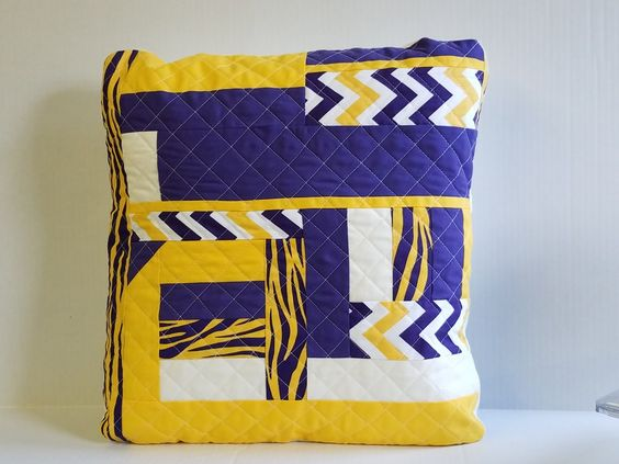 Purple and gold quilted pillow cover. Your favorite colors would look fantastic on your sofa during the big game. Email me at mary.marcotte@gmail.com.  fleurdelisquilts.blogspot.com