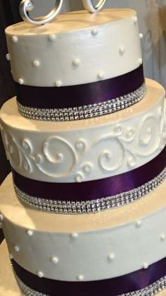 Small wedding cake with dark purple ribbon and some bling