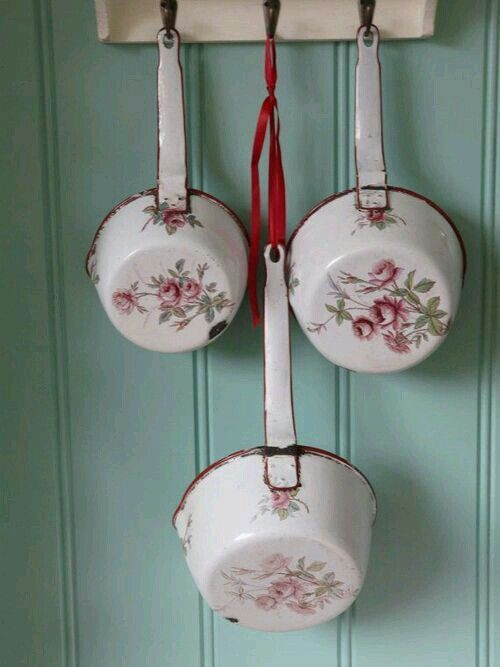 White enamelware  with roses.