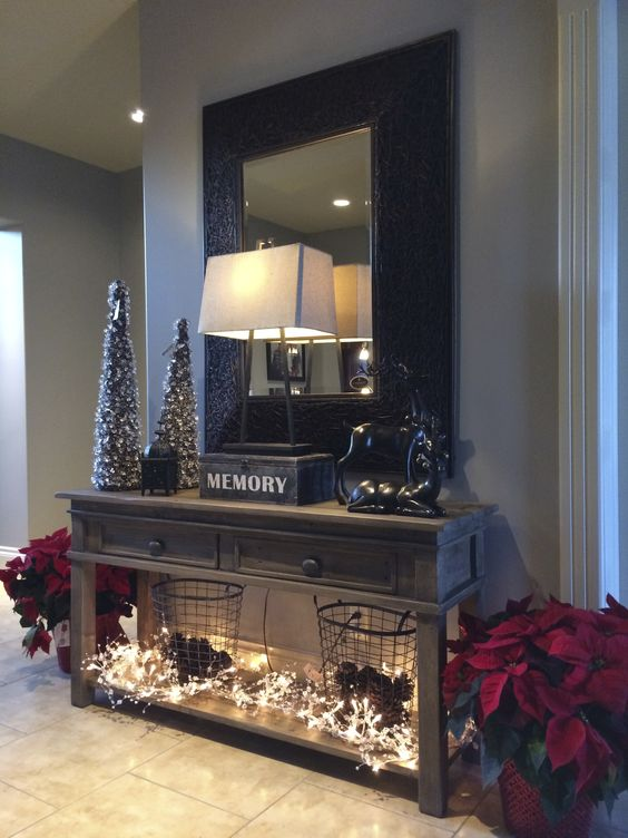 Entry Hallway Decor idea: Poinsettias, Christmas lights, wire baskets filled with pinecones.