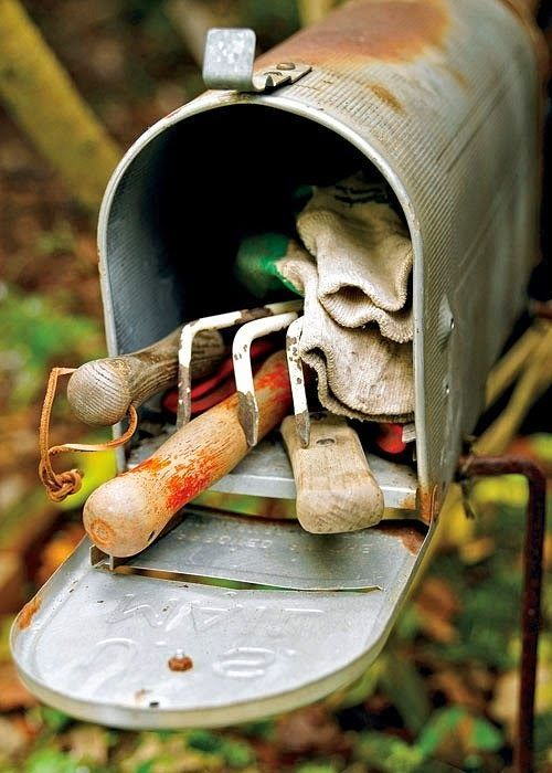 Dishfunctional Designs: The Upcycled Garden - Great way to keep up with garden tools,hammers,etc really whatever will fit inside the old mailbox.: