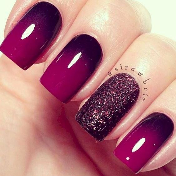 Maroon ombre nails with glitter feature nail.: