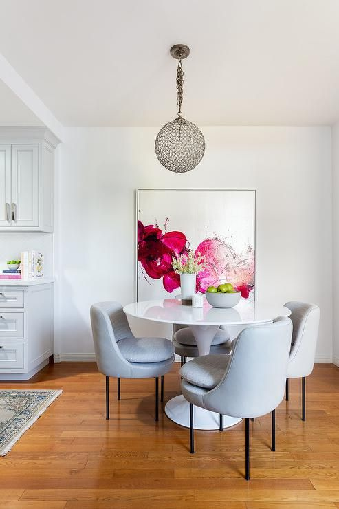 Styled Dining Room Designed With A White Tulip Table And Dove Gray