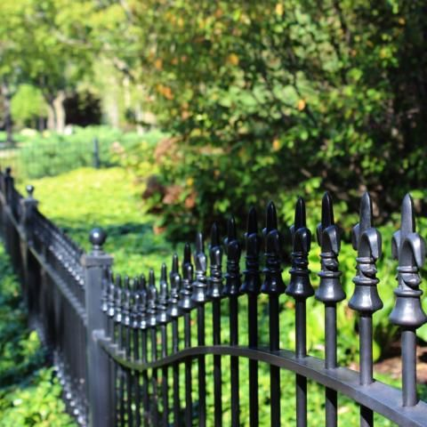 An Ornamental Wrought Iron Fence Can Be Design To Follow The Slope Of Your Yard Backyard Fences Fence Design Easy Fence