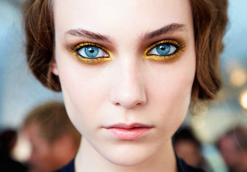 The gold would enhance green eyes, too... But maybe a lilac purple is also a possibility.