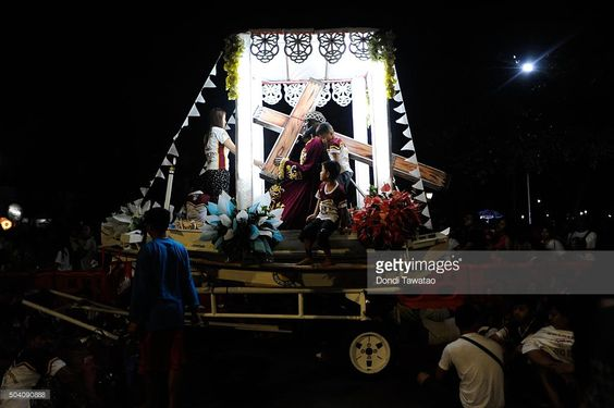 Replicas of the Black Nazarene are lined up in a road at dawn during the Feast of the Black Nazarene on January 9, 2016 in Manila, Philippines. The Feast of the Black Nazarene culminates in a day long procession on January 9 as barefoot devotees march to see and touch the image of the Black Nazarene. The Black Nazarene is a dark wood sculpture of Jesus brought to the Philippines in 1606 from Spain and considered miraculous by Filipino devotees. As many as 6 million devotees are expected to…
