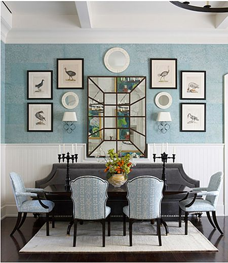 Light and relaxing color scheme with bench seating and unexpected wall decor