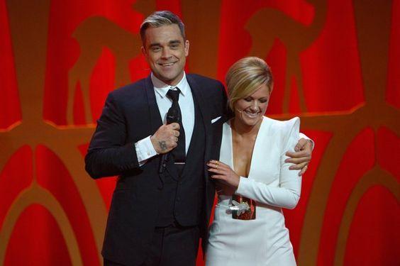 Pin for Later: Vom Schlager-Sternchen zur Pop-Ikone: Seht Helene Fischer's Verwandlung im Zeitraffer November 2013 Mit Robbie Williams beim Bambi in Berlin