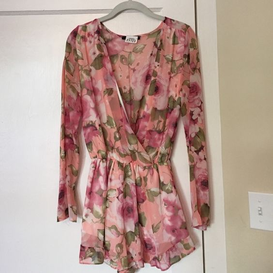 Nasty Gal floral romper!! Adorable floral romper from Nasty Gal!! Deep V front with loose fitting sleeves and ruffle detailing at the bottom of the shorts. Perfect for spring and summer with sandals or even dress it up with wedges or booties! Honey Punch Dresses Mini